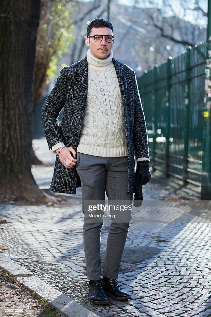 Gianmarco Depretisia wears a dark checkered coat with a white knit turtleneck sweater, and gray trousers during the Milan Men's Fashion Week Fall/Winter 2016/17 on January 16, 2016 in Milan, Italy.
