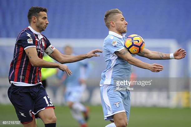 Gianmarco Ferrari of FC Crotone compete for the ball with Ciro Immobile of SS Lazio during the Serie A match between SS Lazio and FC Crotone at...