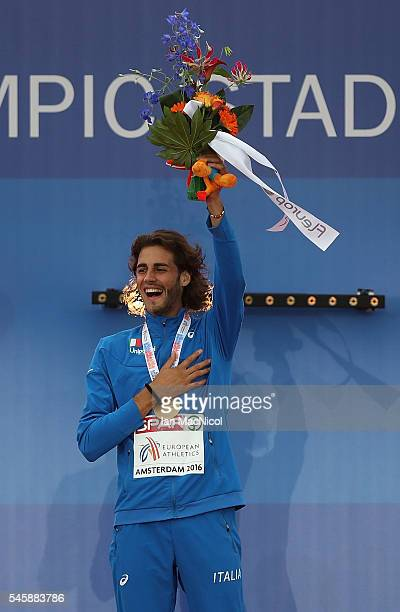 Gianmarco Tamberi of Italy celebrates on the podium after winning gold in the final of the mens high jump on day five of The 23rd European Athletics...