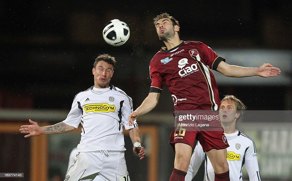 Gianmario Comi (R) of Reggina Calcio competes for the ball n air with Manuel Coppola of AC Cesena during the Serie B match between Reggina Calcio and AC Cesena at Stadio Oreste Granillo on March 15, 2013 in Reggio Calabria, Italy.