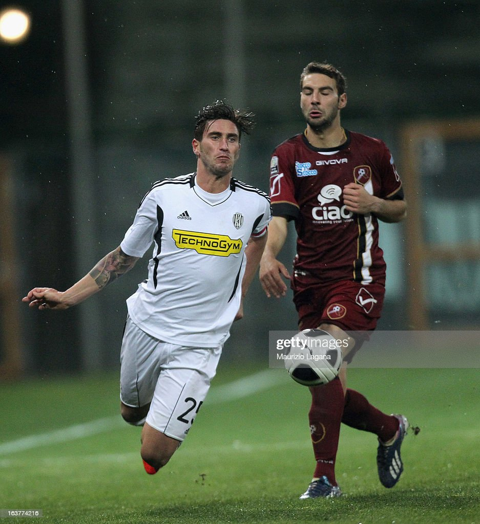 Gianmario Comi (R) of Reggina Calcio competes for the ball with Andrea Rossi of AC Cesena during the Serie B match between Reggina Calcio and AC Cesena at Stadio Oreste Granillo on March 15, 2013 in Reggio Calabria, Italy.