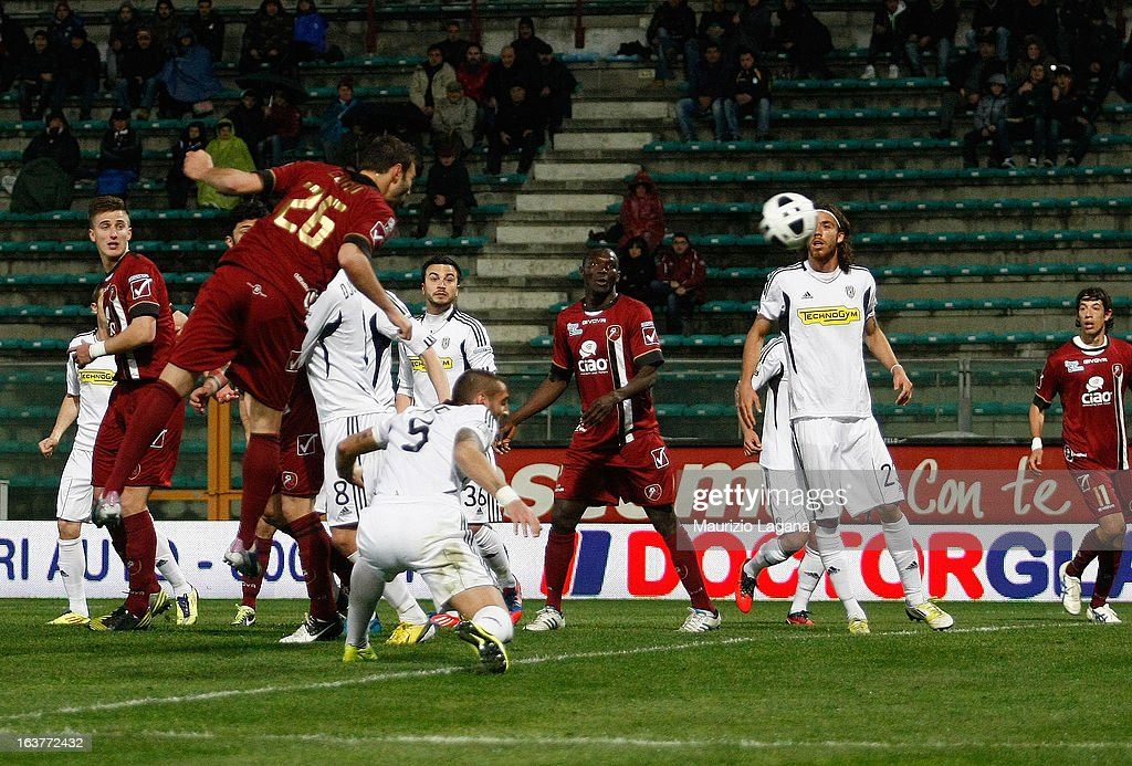Gianmario Comi of Reggina Calcio scores the opening goal during the Serie B match between Reggina Calcio and AC Cesena at Stadio Oreste Granillo on March 15, 2013 in Reggio Calabria, Italy.