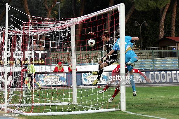 Gianmario Comi of Reggina Calcio scores their fist goa during the Serie B match between US Grosseto and Reggina Calcio at Stadio Olimpico on December...