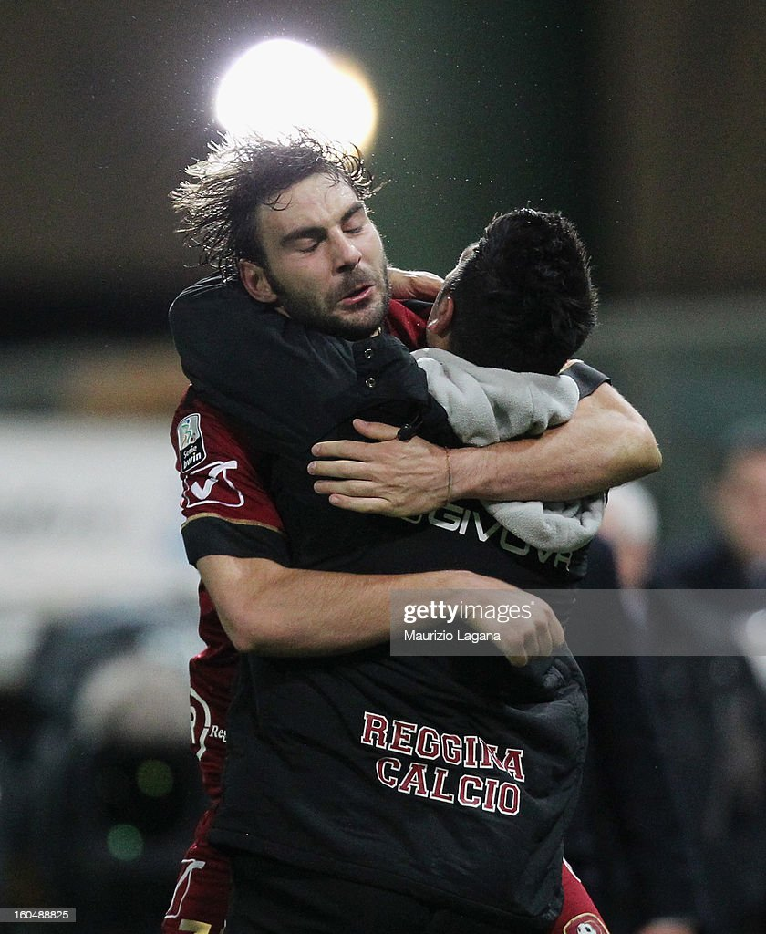 Gianmario Comi of Reggina celebrates after scoring the equalizing goal with his athletic trainer Antonio Le Pera during the Serie B match between Reggina Calcio and Hellas Verona at Stadio Oreste Granillo on February 1, 2013 in Reggio Calabria, Italy.