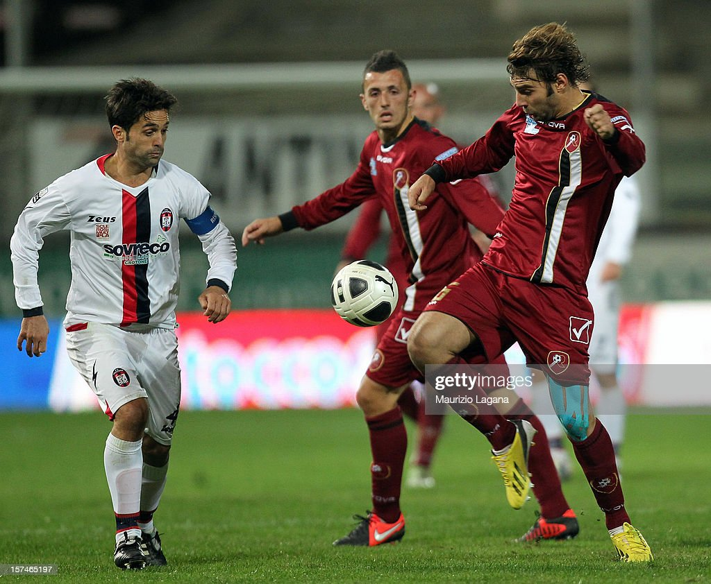 Gianmario Comi (R) of Reggina competes for the ball with Antonio Galardo of Crotone during the Serie B match between Reggina Calcio and FC Crotone at Stadio Oreste Granillo on December 3, 2012 in Reggio Calabria, Italy.