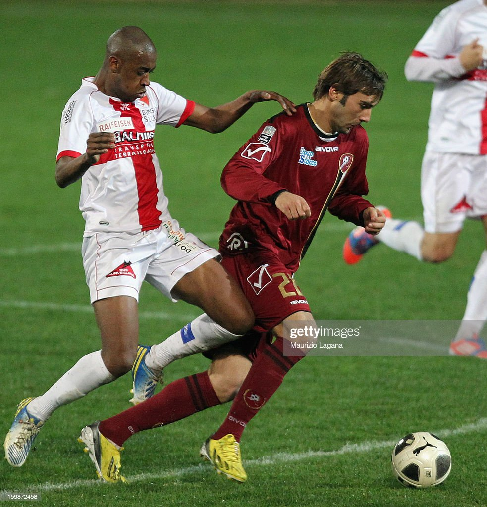 Gianmario Comi (R) of Reggina competes for the ball with Jelson Fernandes of Sion during the friendly match between Reggina Calcio and FC Sion on January 18, 2013 in Reggio Calabria, Italy.