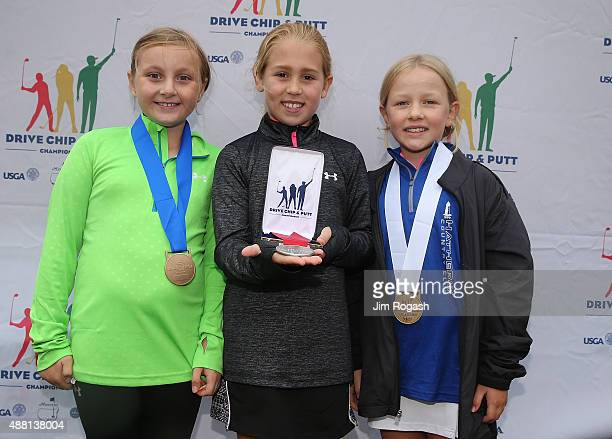 Gianna Papa overall competition first place winner poses with medalists Carys Jenessy and Jillian Johnson in the Girls 79 group pose with their medal...