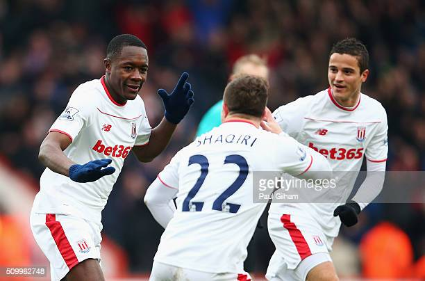 Giannelli Imbula of Stoke City celebrates scoring his team's first goal with his team mates Xherdan Shaqiri of Stoke City and Ibrahim Afellay during...