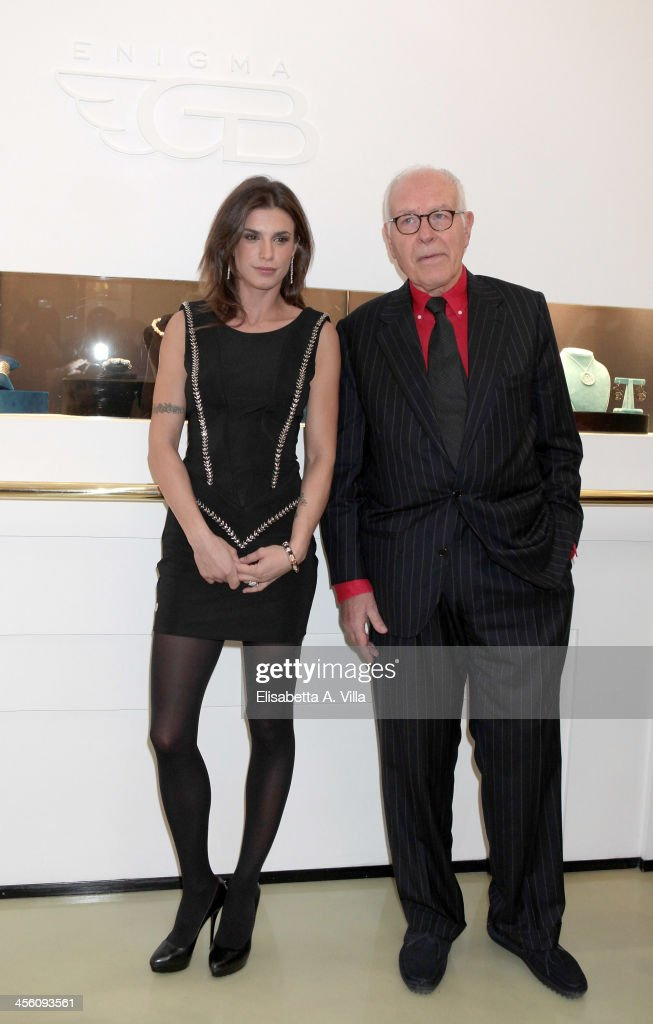 Gianni Bulgari (R) and Elisabetta Canalis attend the 'Luce Preziosa' presentation at the GB ENIGMA by Gianni Bulgari boutique on December 13, 2013 in Rome, Italy. Luce Preziosa is an inspiring christmas jewellery and light TechoArt opera by the artist Geo Florenti.