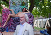 Gianni de Luigi stands in front of actor Massimo Cemolani sited naked on a chair by Gaetano Pesce at the Italian Pavillion on June 2 2011 in Venice...