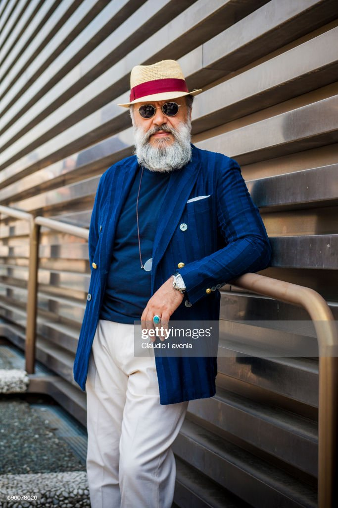 Gianni Fontana wears a blue blazer jacket, white pants and panama hat during Pitti Immagine Uomo 92. at Fortezza Da Basso on June 14, 2017 in Florence, Italy.