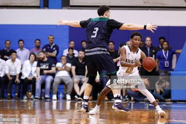Gianni Hunt of Bishop Montgomery High School looks to pass the ball while being guarded by LiAngelo Ball of Chino Hills High School during the game...