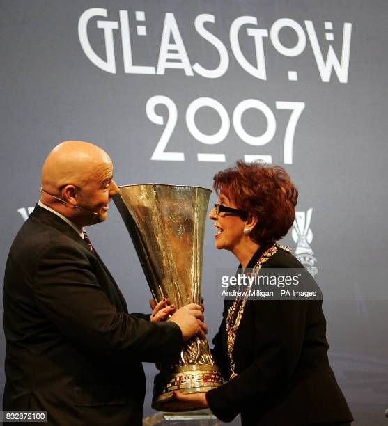 Gianni Infantino acting UEFA Chief Executive hands the Uefa cup to Glasgow Provost Liz Cameron during the UEFA Cup Handover and Final Phase Draw