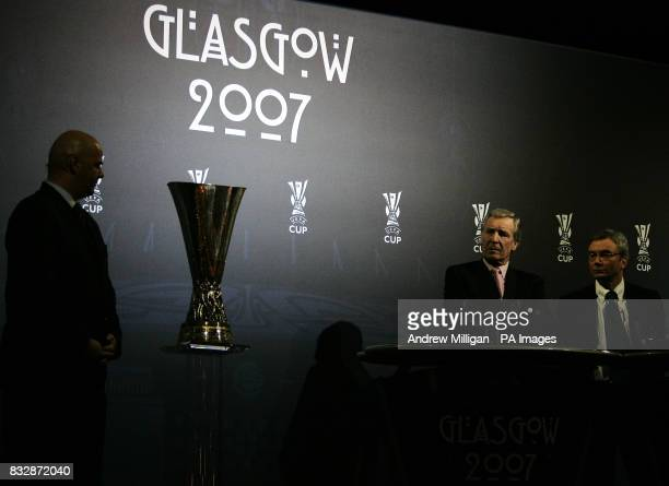Gianni Infantino acting UEFA Chief Executive with Scottish FA Chief Executive David Taylor and ex Celtic Player Billy McNeill look at the UEFA cup...