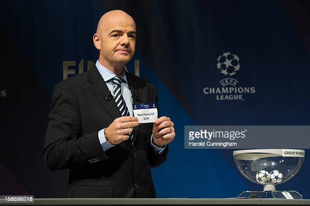 Gianni Infantino General Secretary of the UEFA shows the name Real Madrid during the UEFA Champions League round of 16 draw at the UEFA headquarters...