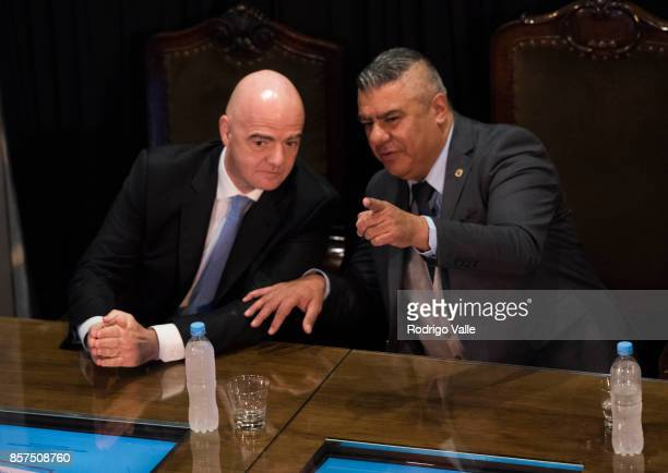 Gianni Infantino president of FIFA talks to Claudio Chiqui Tapia president of AFA during a press conference at AFA as part of the official visit of...