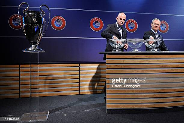 Gianni Infantino UEFA General Secretary and Giorgio Marchetti UEFA Competition Director proceed to the UEFA Champions League Q2 qualifying round draw...