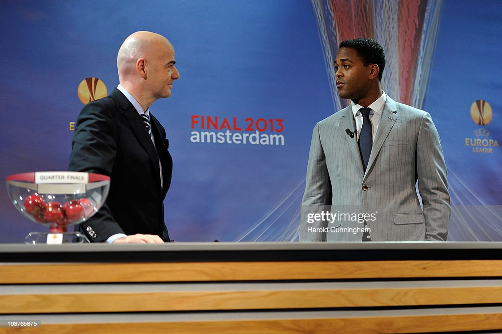 Gianni Infantino, UEFA General Secretary (L) and Patrick Kluivert, UEFA Europa League Final Ambassador (R) speak on stage during the UEFA Europa League quarter finals draw at the UEFA headquarters on March 15, 2013 in Nyon, Switzerland.