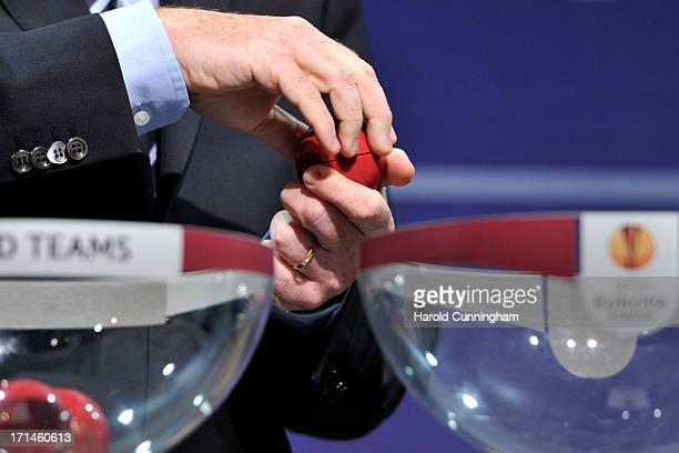 Gianni Infantino UEFA General Secretary opens a draw ball during the UEFA Europa League Q1 qualifying round draw at the UEFA headquarters on June 24...