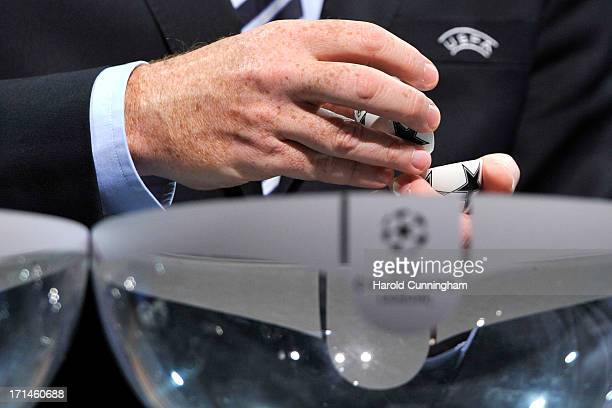 Gianni Infantino UEFA General Secretary opens a draw ball during the UEFA Champions League Q2 qualifying round draw at the UEFA headquarters on June...