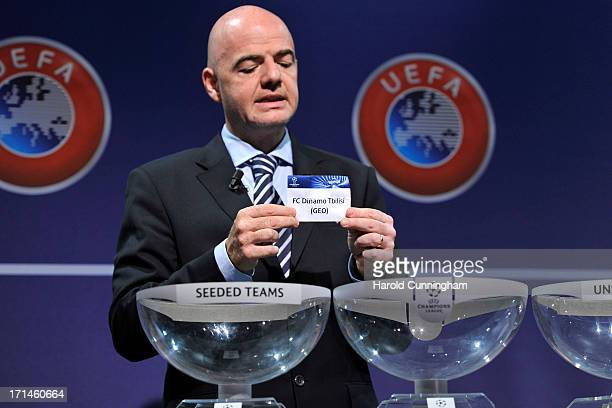 Gianni Infantino UEFA General Secretary shows the name Dinamo Tbilisi during the UEFA Champions League Q2 qualifying round draw at the UEFA...