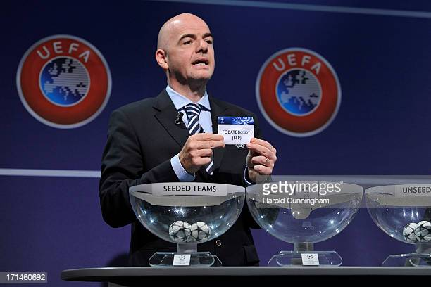 Gianni Infantino UEFA General Secretary shows the name FC BATE Borisov during the UEFA Champions League Q2 qualifying round draw at the UEFA...