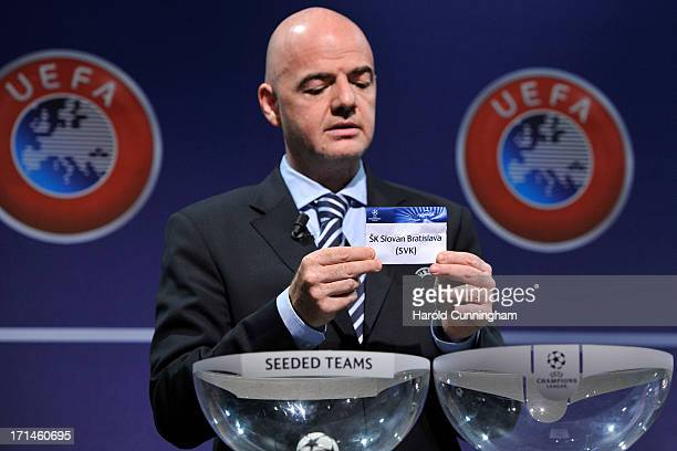Gianni Infantino UEFA General Secretary shows the name SK Slovan Bratislava during the UEFA Champions League Q2 qualifying round draw at the UEFA...