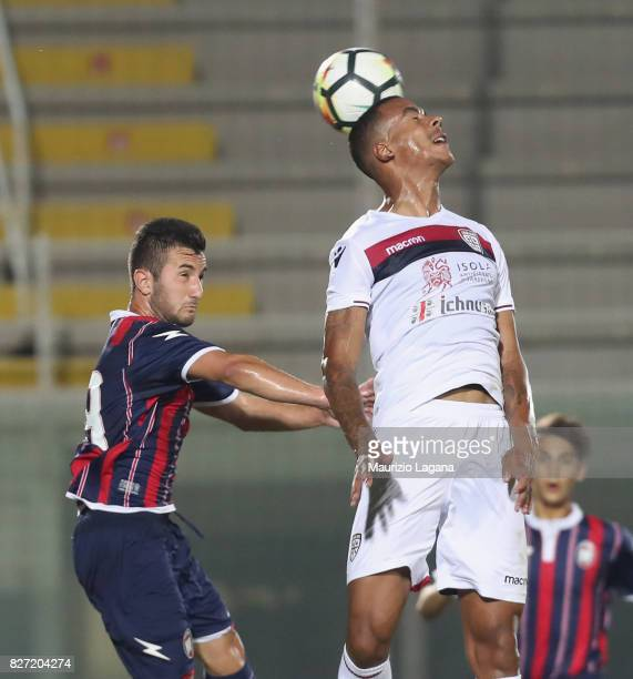 Gianni Liviera of Crotone competes for the ball with Senna Miangue of Cagliari during the PreSeason Friendly match between FC Crotone and Cagliari...