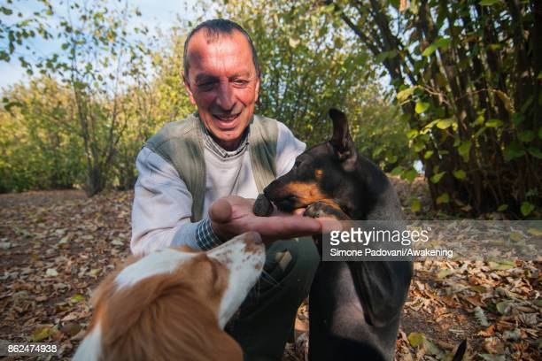 Gianni Monchiero president of the University of truffle dogs in Roddi let his dog smell a truffle to train them on October 17 2017 in the Barolo...