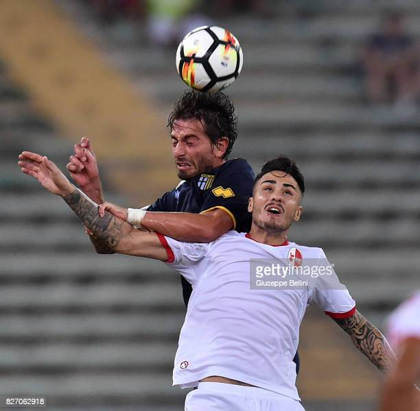 Gianni Munari of Parma Calcio and Aniello Salzano of AS Bari in action during the TIM Cup match between AS Bari and Parma Calcio at Stadio San Nicola...