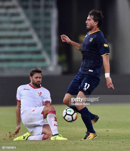 Gianni Munari of Parma Calcio and Archimede Morleo of AS Bari in action during the TIM Cup match between AS Bari and Parma Calcio at Stadio San...