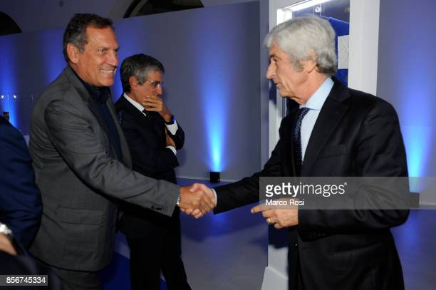 Gianni Rivera former player AC Milan and Pino Capua shackes the hands during the new Italian Football Federation logo unveiling at Maxxi Museum on...