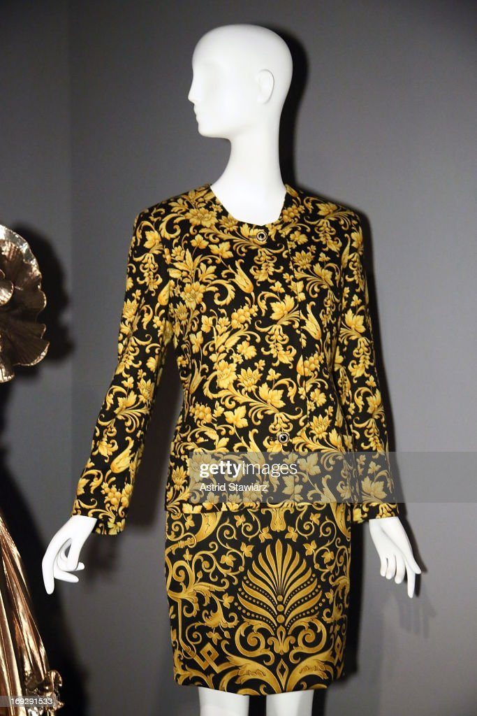 A Gianni Versace suit, circa 1992 is shown at the RetroSpective Press Preview at The Museum at FIT on May 22, 2013 in New York City.