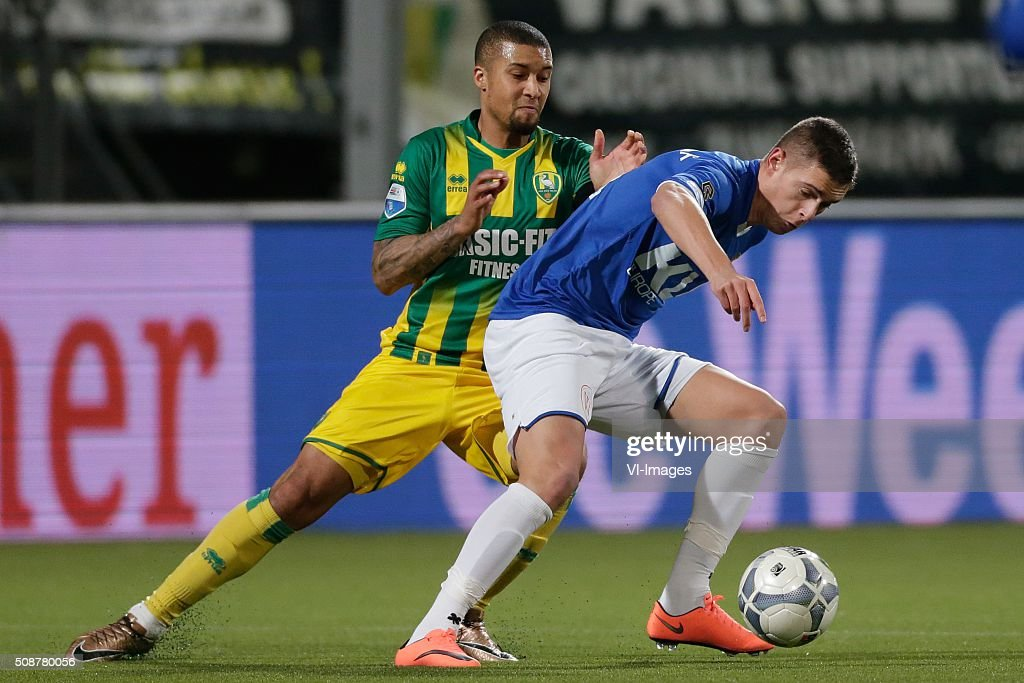 Gianni Zuiverloon of ADO Den Haag, Kristoffer Peterson of Roda JC during the Dutch Eredivisie match between ADO Den Haag and Roda JC Kerkrade at Kyocera stadium on February 06, 2016 in The Hague, The Netherlands