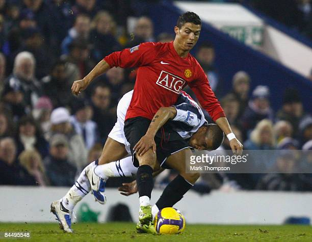 Gianni Zuiverloon of West Bromwich Albion tangles with Cristiano Ronaldo of Manchester United during the Barclays Premier League match between West...
