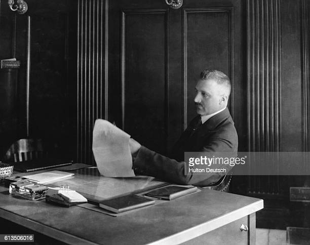 AP Giannini the founder of the Bank of America in his office in San Francisco California 1923