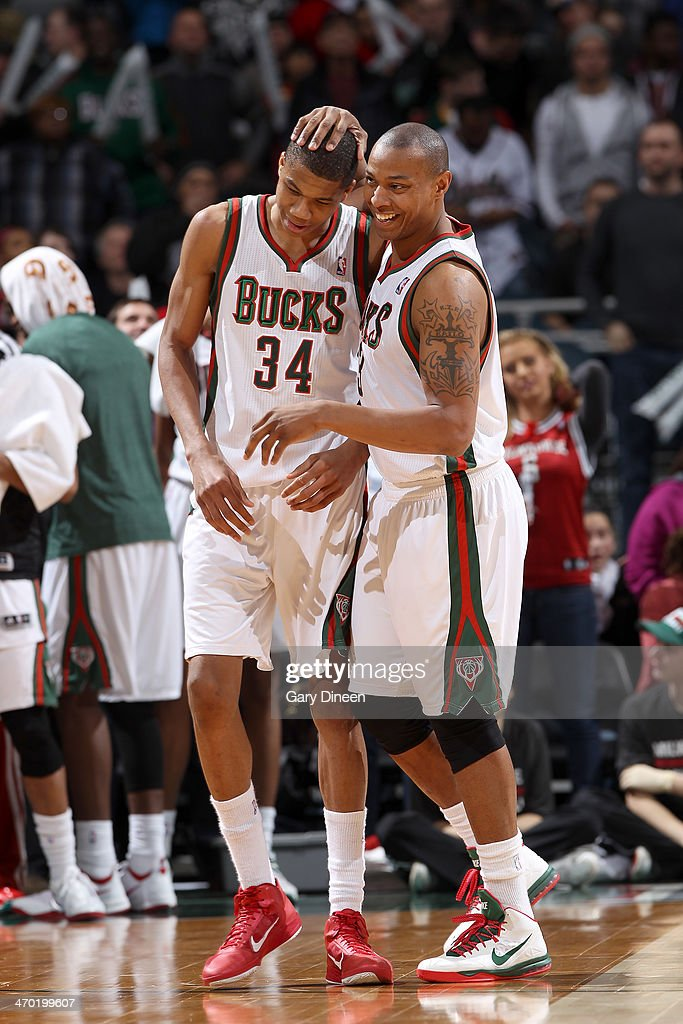 Giannis Antetokounmpo #34 and Caron Butler #3 of the Milwaukee Bucks share a laugh on-court during the game against the Orlando Magic on February 18, 2014 at the BMO Harris Bradley Center in Milwaukee, Wisconsin.
