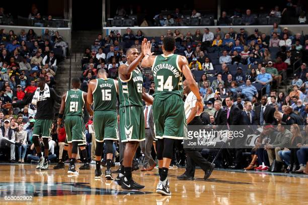 Giannis Antetokounmpo and Khris Middleton of the Milwaukee Bucks high five each other during the game against the Memphis Grizzlies on March 13 2017...