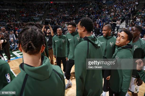 Giannis Antetokounmpo and Khris Middleton of the Milwaukee Bucks with their teammates huddle before the game against the Washington Wizards on...