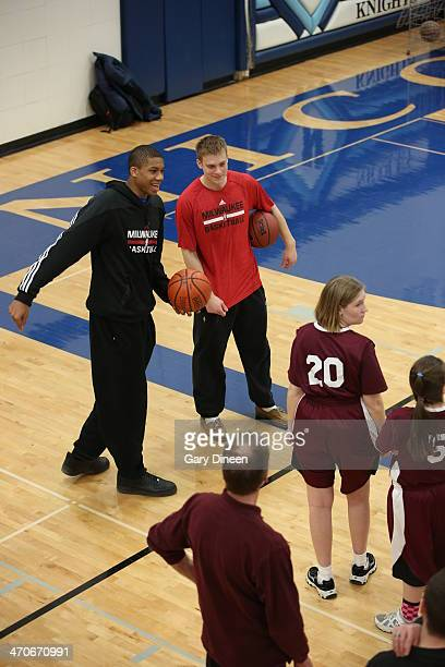 Giannis Antetokounmpo and Nate Wolters of the Milwaukee Bucks interact with participants during a Special Olympics basketball skills clinic on...
