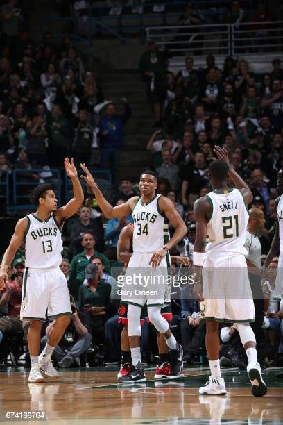 Giannis Antetokounmpo Malcolm Brogdon and Tony Snell of the Milwaukee Bucks high five during the game against the Toronto Raptors during Game Six of...