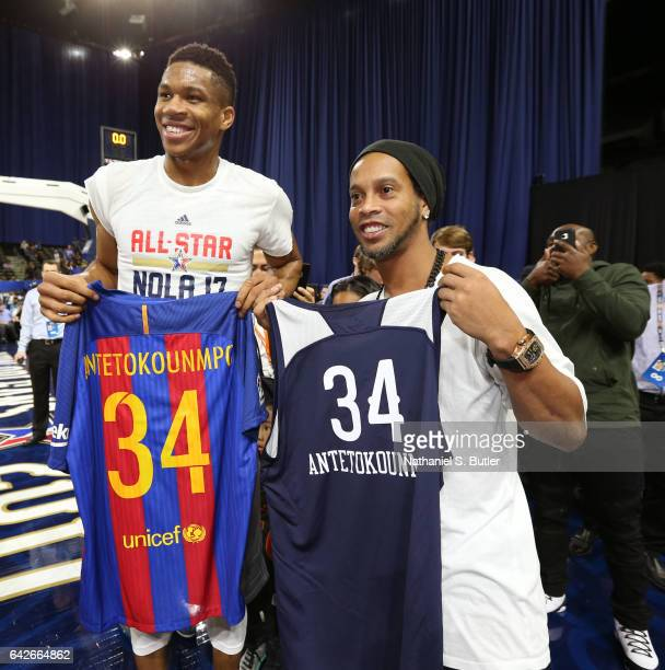 Giannis Antetokounmpo of the Eastern Conference All Star Team exchanges jerseys and poses for a photo with soccer playerRonaldinho during NBA AllStar...