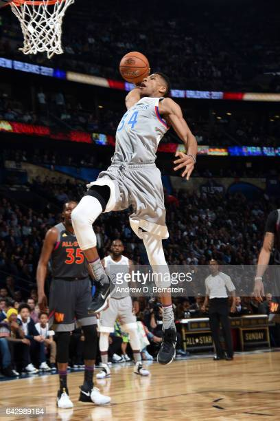 Giannis Antetokounmpo of the Eastern Conference AllStar Team dunks the ball against the Western Conference AllStar Team during the NBA AllStar Game...