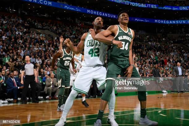 Giannis Antetokounmpo of the Milwaukee Bucks and Al Horford of the Boston Celtics await the ball on December 4 2017 at the TD Garden in Boston...
