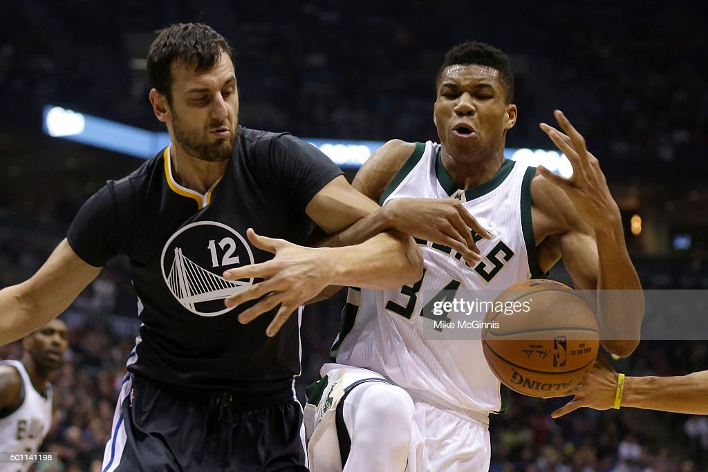 <a gi-track='captionPersonalityLinkClicked' href=/galleries/search?phrase=Giannis+Antetokounmpo&family=editorial&specificpeople=11078379 ng-click='$event.stopPropagation()'>Giannis Antetokounmpo</a> #34 of the Milwaukee Bucks and <a gi-track='captionPersonalityLinkClicked' href=/galleries/search?phrase=Andrew+Bogut&family=editorial&specificpeople=207105 ng-click='$event.stopPropagation()'>Andrew Bogut</a> #12 of the Golden State Warriors scramble for a loose ball during the first quarter at BMO Harris Bradley Center on December 12, 2015 in Milwaukee, Wisconsin.