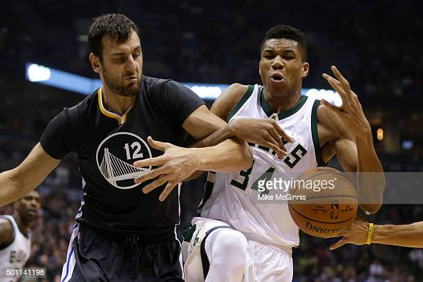Giannis Antetokounmpo of the Milwaukee Bucks and Andrew Bogut of the Golden State Warriors scramble for a loose ball during the first quarter at BMO...
