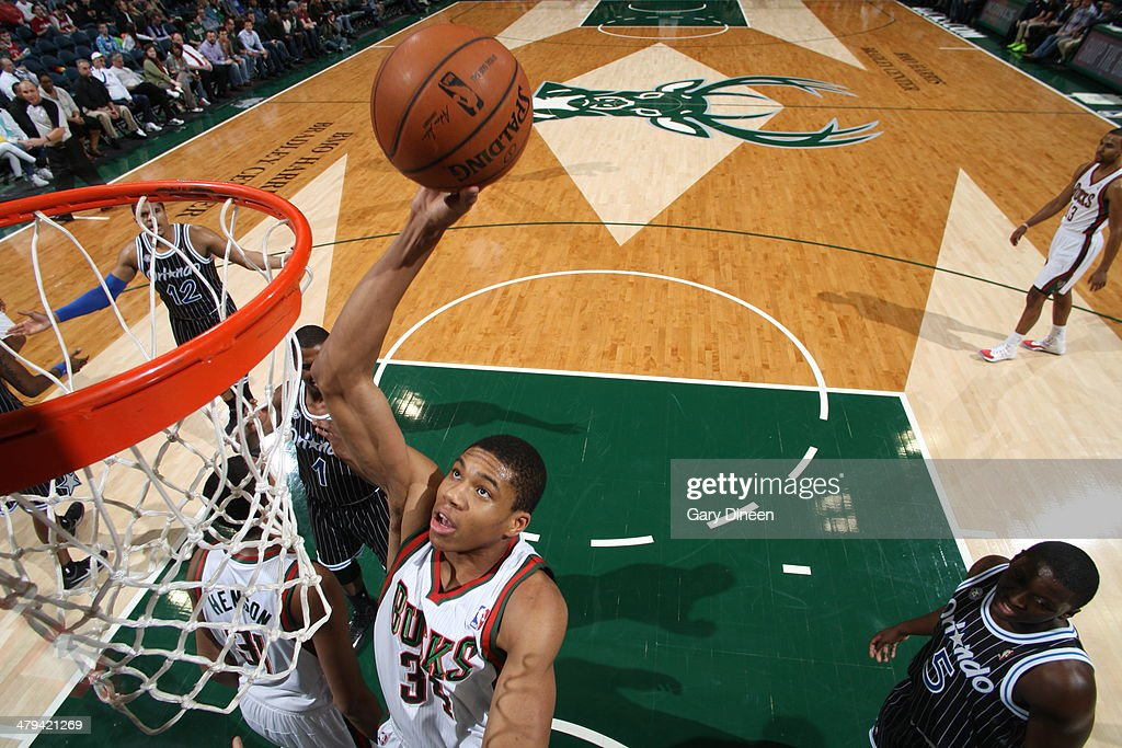 Giannis Antetokounmpo #34 of the Milwaukee Bucks attempts a dunk against the Orlando Magic on March 10, 2014 at the BMO Harris Bradley Center in Milwaukee, Wisconsin.