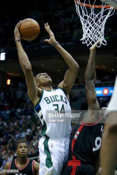 Giannis Antetokounmpo of the Milwaukee Bucks attempts a layup over Serge Ibaka of the Toronto Raptors in the first quarter in Game Six of the Eastern...