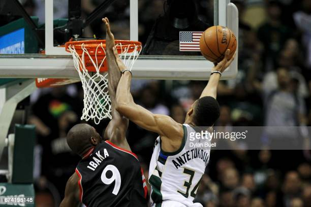Giannis Antetokounmpo of the Milwaukee Bucks attempts a layup while being guarded by Serge Ibaka of the Toronto Raptors in the third quarter in Game...