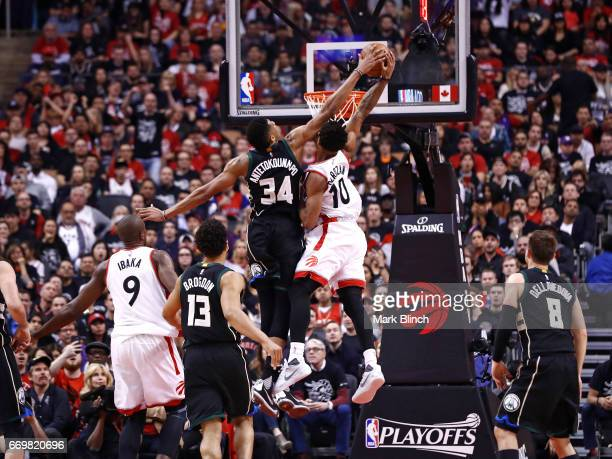 Giannis Antetokounmpo of the Milwaukee Bucks blocks a shot against DeMar DeRozan of the Toronto Raptors on April 15 2017 during Game One of Round One...